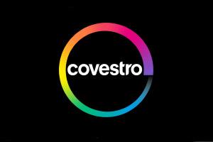 Logotipo de Covestro. Círculo de colores con el nombre de la empresa en medio